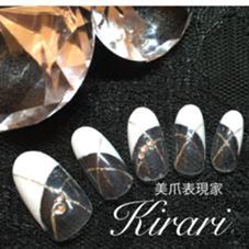 デザインネイルの一つです! 定番白の変形フレンチ ネイルサロン ☆Kirari☆所属・梶原あけみのフォト