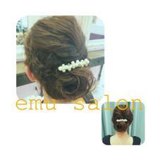 サイドは編み込みでトップはふんわりとした大人可愛いルーズなまとめ髪  emu salon所属・関ちぐさのスタイル