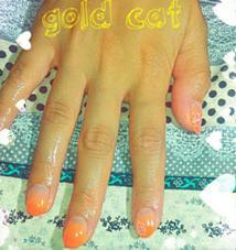 お客様ネイル オレンジグラデーション&お花アート gold cat所属・goldcatのフォト